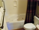 Master Bathroom has Jacuzzi Tub/Shower and a Grab Bar to get in to the Tub.