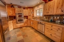 Granite tile counter tops, stainless steel appliances and a gas stove.