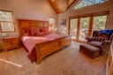 Master Suite has a King Size Bed. Walk out to the Hot Tub on the Deck.