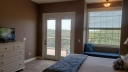 Master Bedroom has a King, an Alcove, Flat Screen Cable TV and the Bathroom adjoins the Bedroom. Great Views of the Ozark Mountains, Table Rock Lake and Silver Dollar City.