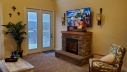 Snuggle by the fireplace and enjoy the breathtaking views right from the living room.