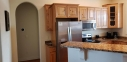 This kitchen has a regular drip coffee maker and a K cup coffee machine. It is a fully stocked kitchen.
